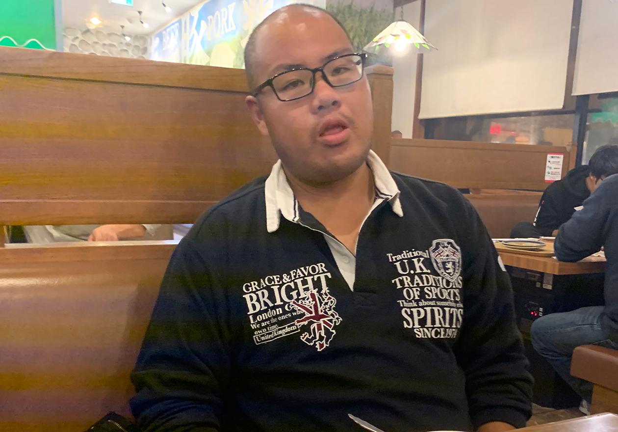 スタッフの田中の写真