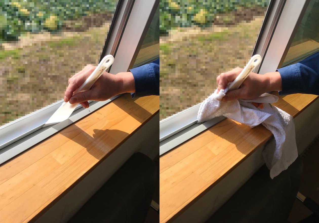 タオルを巻いたプラスチックヘラで窓のサッシ部分を掃除している様子