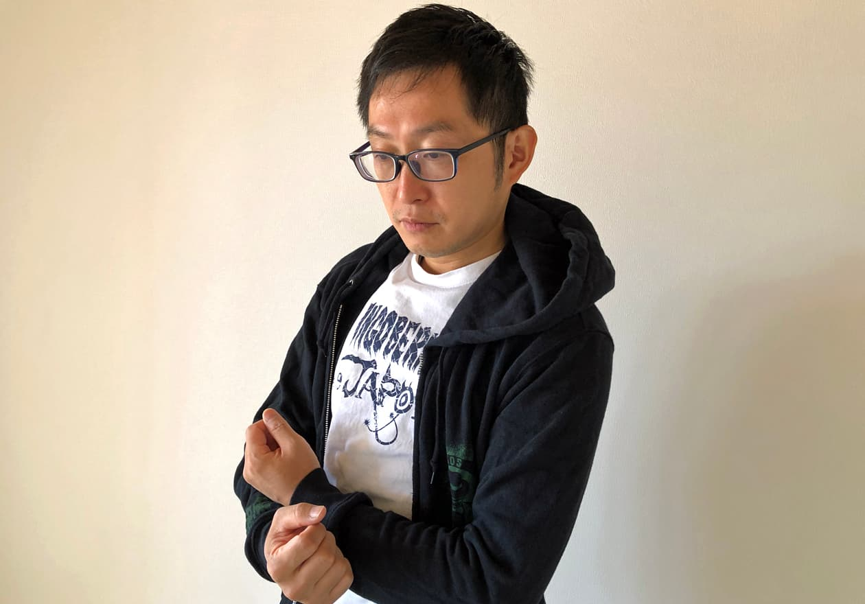 笑顔の岡本さんの写真